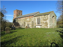 TF3579 : The Church of St Michael and part of its burial ground at Burwell by Peter Wood