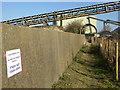 TQ7175 : Public footpath under conveyor belt by Robin Webster