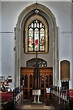 TL8866 : Great Barton: Holy Innocents Church: The font and very tall tower arch by Michael Garlick