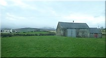 J2933 : Field barns overlooking the A25 on the eastern outskirts of Kilcoo by Eric Jones