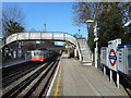 TQ2591 : Train and Footbridge at West Finchley by Des Blenkinsopp