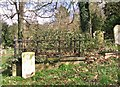 TG2408 : A Commonwealth war grave beside a burial vault by Evelyn Simak