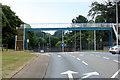 SX9885 : Footbridge across the A376 at Exton by David Dixon
