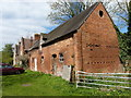 SP2490 : Stable block, Church Farm by Richard Law