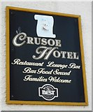NO4102 : Sign for the Crusoe Hotel by Richard Sutcliffe