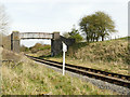 SE0253 : Footbridge over the railway, with quarter milepost by Stephen Craven