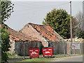 TF5319 : Derelict buildings by Adrian S Pye