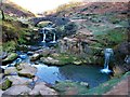 SK0068 : Waterfalls and Packhorse Bridge at Three Shire Heads by G Laird