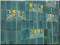 ST5874 : Green ceramic tiles on The Hare on the Hill by Neil Owen