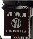 TQ5487 : Sign for the Wildwood, Hornchurch by JThomas