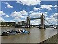 TQ3380 : Waste collection barge near Tower Bridge by Richard Humphrey