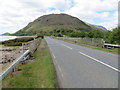 NM9862 : Lochside road (A861) and bridge crossing River Gour by Peter Wood
