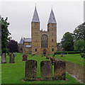 SK7053 : Southwell Minster: the west front on a wet afternoon by John Sutton