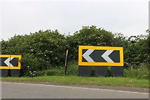 TF0686 : Bend left arrows on Lincoln Road, Faldingworth by David Howard