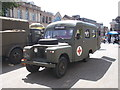 TL1998 : Classic Land Rover military ambulance on Cathedral Square, Peterborough by Paul Bryan