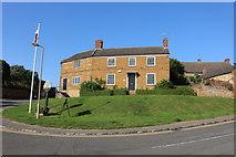 SP8490 : Houses in Cottingham by David Howard