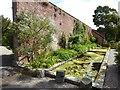 NX0942 : Garden wall, Logan Botanic Garden by Oliver Dixon
