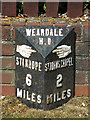 NY9038 : Milepost on the A689 at the east end of Westgate by Mike Quinn