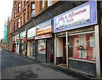 NS5565 : Shops on Govan Road by Richard Sutcliffe