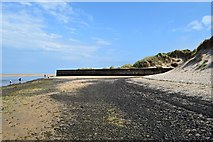 NU1535 : Stone pier in Budle Bay by John Myers