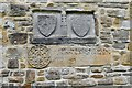 NZ1114 : Wycliffe, St. Mary's Church: Heraldic symbols inserted into the south wall 1 by Michael Garlick