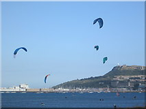 SY6774 : Kite surfers, Portland Harbour by Peter S