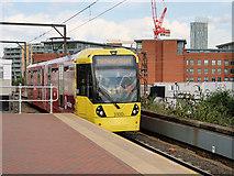 SJ8297 : Airport Tram Arriving at Cornbrook by David Dixon