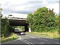 TQ5097 : M25 bridge over Romford Road, Passingford Bridge by Malc McDonald