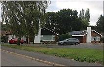 TL2970 : Bungalows on Glebe Road, Hemingford Grey by David Howard