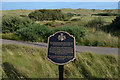 NJ9820 : Plaque at Trump International Golf Links, Scotland  by Andrew Tryon