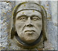 SK9324 : Stone head at the Church of St John the Baptist by Mat Fascione