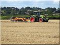 SK2936 : Disc harrowing a harvested field by Ian Calderwood
