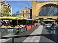 TQ3082 : Artisan food stalls in front of Kings Cross Station by Philip Jeffrey