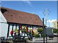 TQ4674 : Hanging baskets outside The George Staples at Blackfen by Marathon