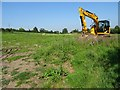 SO9036 : Excavator in a field by Philip Halling