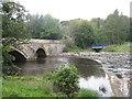 NT0667 : Howden Bridge and weir, Livingston by M J Richardson