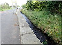 J0326 : The Camlough River flowing alongside the A25 by Eric Jones