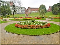 SJ8298 : Salford, flower beds by Mike Faherty