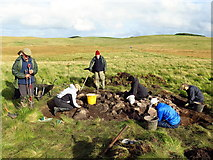 NY8993 : Excavating a stony mound, Fawdon Hill by Andrew Curtis