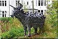NN5617 : Highland cow sculpture, Strathyre by Jim Barton