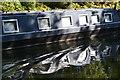 SO9890 : Rippled reflections of a passing narrowboat by David Martin