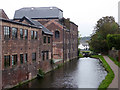SO8986 : Stourbridge Canal - lock No. 13 and former industrial buildings by Chris Allen