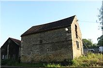 SP9694 : Old barn in Bulwick by David Howard