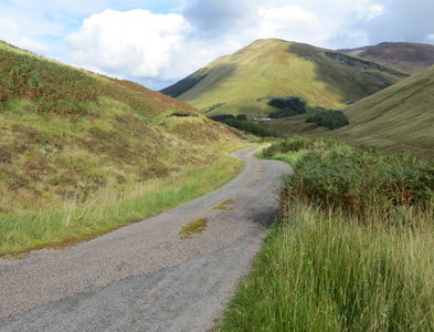 NN2488 : Minor road between Lower and Upper Glenfintaig in Glen Gloy by Peter Wood
