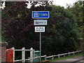 TL9034 : Bures Hamlet Village Name sign on Bures Bridge by Adrian Cable