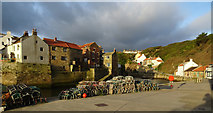 NZ7818 : Lobster pots along Roxby Beck, Staithes by habiloid