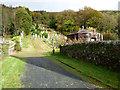 NS1682 : St Munn's Parish Church graveyard by Thomas Nugent