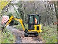 NZ1049 : Ditch clearing on the old railway by Robert Graham