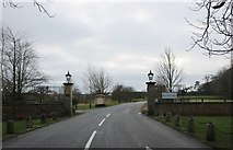 SP6943 : The entrance to Whittlebury Park by David Howard