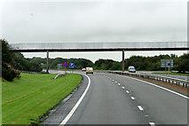 NS3336 : Footbridge over the A78 near Shewalton by David Dixon